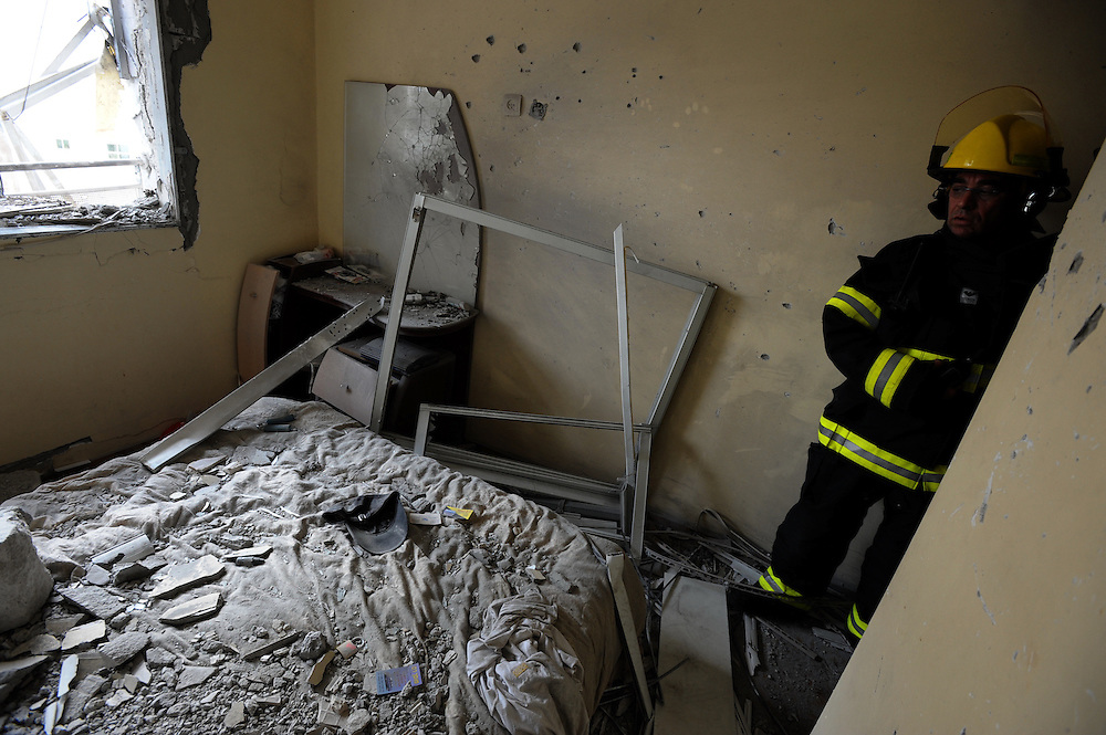 Ashdod, Israel - November 17, 2012: Israeli fire fighters are inspecting the damage to a house that was hit by a rocket fired from Gaza Strip, at the fourth day of Operation Pillar of Defense. Photo by Gili Yaari - Israel Photojournalist