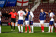 Wwords between friends as Jake Clarke-Salter England U21s (Vitesse Arnhem, loan from Chelsea) and Ross McCrorie Scotland U21s (Rangers FC)come together during the U21 UEFA EUROPEAN CHAMPIONSHIPS match Scotland vs England at Tynecastle Stadium, Edinburgh, Scotland, Tuesday 16 October 2018.