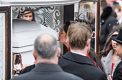 "© Licensed to London News Pictures. 14/02/2020. Sevenoaks, UK. Mourners kiss and touch the coffin of Joey Smith as it leaves St John the Baptist church in Sevenoaks, Kent following the funeral service of traveller brothers Billy and Joe Smith. The twin brothers, who were made famous by the television programme ""My Big Fat Gypsy Wedding"", were found hanged in woodland three days after Christmas. Photo credit: Ben Cawthra/LNP"