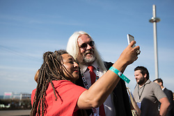 © Licensed to London News Pictures . 24/09/2017. Brighton, UK. Tosh McDonald poses for a selfie alongside protesters calling for Iain McNicol to resign , outside the conference venue . The first day of the Labour Party Conference in and around The Brighton Centre . Photo credit: Joel Goodman/LNP