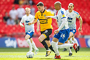 Tranmere Rovers midfielder David Perkins (17), Tranmere Rovers defender Sid Nelson (4), Newport County forward Padraig Amond (9), Tranmere Rovers defender Jake Caprice (14) during the EFL Sky Bet League 2 Play Off Final match between Newport County and Tranmere Rovers at Wembley Stadium, London, England on 25 May 2019.