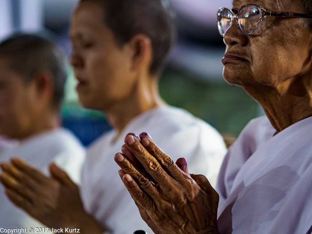25 OCTOBER 2017 - BANGKOK, THAILAND: Bhikkhuni (Buddhist nuns) pray for the late King during the funeral for Bhumibol Adulyadej, the Late King of Thailand. He died in October 2016 and was cremated during an ornate five day funeral on 26 October 2017. He reigned for 70 years and was Thailand's longest serving monarch.         PHOTO BY JACK KURTZ