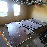 Old doors removed  at the CVB office in Tupelo lay stacked in a back room as work crews demo the interior on Tuesday.