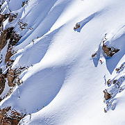 Owen Leeper drops a backcountry cliff in the Tetons.