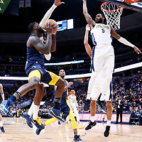 03 April 2018: Indiana Pacers guard Lance Stephenson (1) goes for the layup against Denver Nuggets forward Will Barton (5) during the Denver Nuggets 107-104 victory over the Indiana Pacers, at the Pepsi Center, Denver, Colorado, USA.