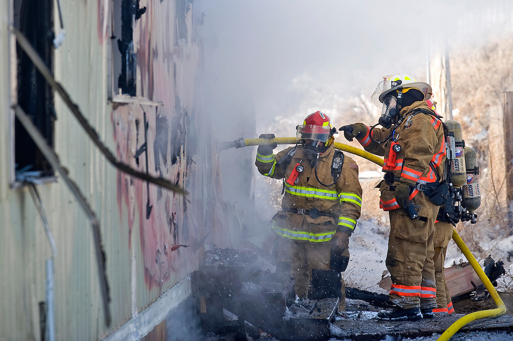 010311       Brian Leddy.Gallup Firefighters work to extinguish a fire in a trailer at Gila Mountain Towing on Monday morning.