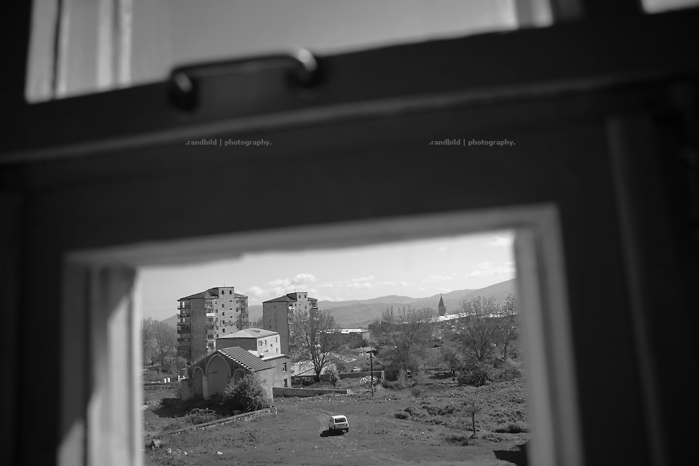 "A view down to Shushi. This image is part of the photoproject ""The Twentieth Spring"", a portrait of caucasian town Shushi 20 years after its so called ""Liberation"" by armenian fighters. In its more than two centuries old history Shushi was ruled by different powers like armeniens, persians, russian or aseris. In 1991 a fierce battle for Karabakhs independence from Azerbaijan began. During the breakdown of Sowjet Union armenians didn´t want to stay within the Republic of Azerbaijan anymore. 1992 armenians manage to takeover ""ancient armenian Shushi"" and pushed out remained aseris forces which had operate a rocket base there. Since then Shushi became an ""armenian town"" again. Today, 20 yeras after statement of Karabakhs independence Shushi tries to find it´s opportunities for it´s future. The less populated town is still affected by devastation and ruins by it´s violent history. Life is mostly a daily struggle for the inhabitants to get expenses covered, caused by a lack of jobs and almost no perspective for a sustainable economic development. Shushi depends on donations by diaspora armenians. On the other hand those donations have made it possible to rebuild a cultural centre, recover new asphalt roads and other infrastructure. 20 years after Shushis fall into armenian hands Babies get born and people won´t never be under aseris rule again. The bloody early 1990´s civil war has moved into the trenches of the frontline 20 kilometer away from Shushi where it stuck since 1994. The karabakh conflict is still not solved and could turn to an open war every day. Nonetheless life goes on on the south caucasian rocky tip above mountainious region of Karabakh where Shushi enthrones ever since centuries."