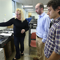 Barbara Hall, a worker with ES&S, Election Systems & Software, shows precinct workers Carlton Hall and CHarlie Buckley the main operations of the voting machine during a testing in Thursday in advance of next week's primary election in Tupelo.
