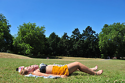 © Licensed to London News Pictures. 26/06/2017. GREENWICH, UK.<br /> Heatwave weather across the UK.<br /> The hot sunny weather continues today as people relax in the sun in Greenwich Park,Greenwich.<br /> (Verbal permission given to photograph)<br /> Photo credit: Grant Falvey/LNP