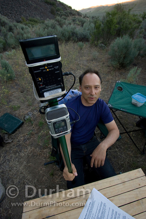 Humboldt University professor of bioacoustics Joe Szewczak holds a patterson ultra-sonic bat detector and recorder that will automatically record the calls of bats that fly near. The device is set-up in the field after nightfall. The Nature Conservnacy's Dutch Henry Falls preserve in central Washington.