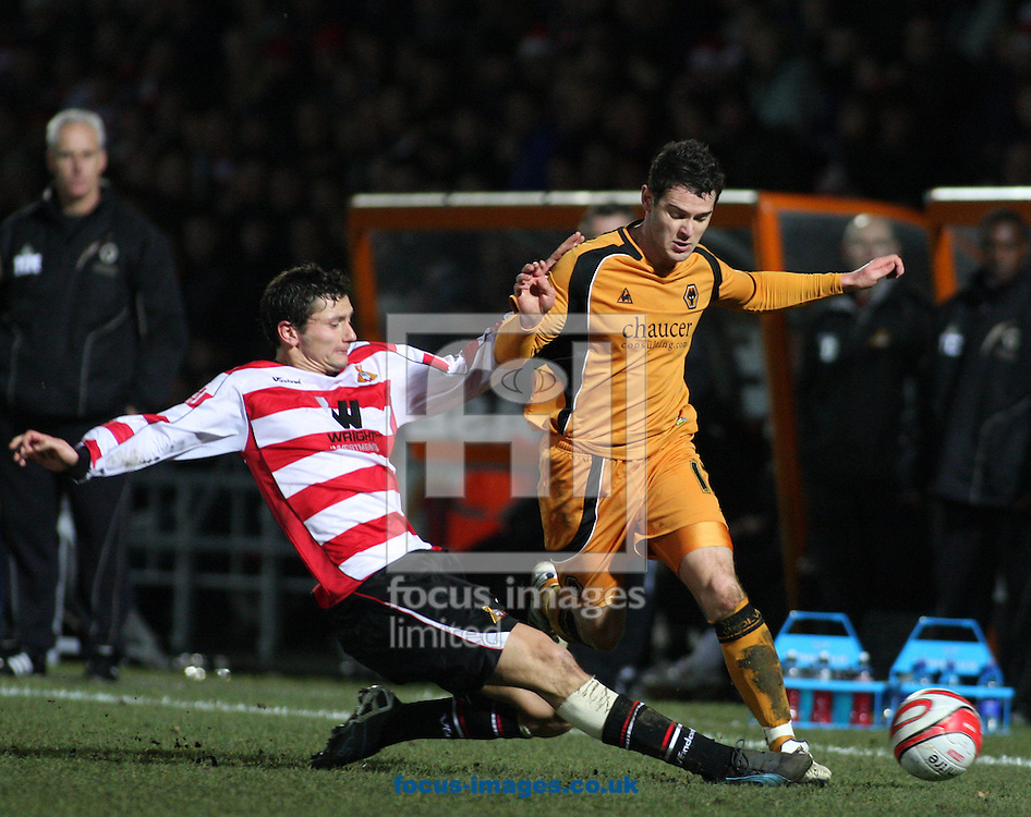 Doncaster - Saturday December 20th 2008: Matthew Jarvis of Wolverhampton Wanderers & John Spicer of Doncaster Rovers in action during the Coca Cola Championship match at The Keepmoat Stadium Doncaster. (Pic by Steven Price/Focus Images)