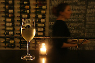 A glass of Hüpler Gruner Veltliner, an Austrian white, sits on a bar at Red + White Wine Bar in the Glen Park neighborhood of San Francisco, CA Friday night, February 26, 2010.