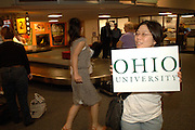 International students at Airpot Photos by Megan Nadolski..Ohio University peer advisor Mito Takeuchi waits for new Ohio University international students to arrive at the airport in Columbus, OH.