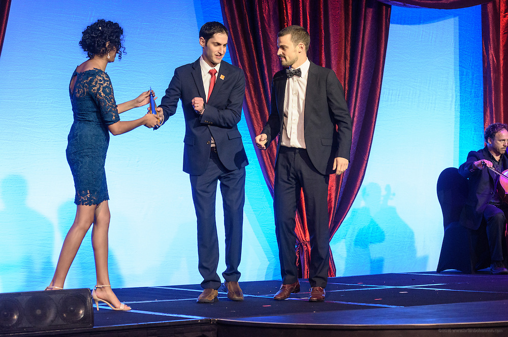 Eli A. Wolff, co-founder of the Sport and Development Project at Brown University, presents Jakob Schillinger of Tuebingen, Germany, with one of the six Core Principle Awards, the Giving award, at the fourth annual Muhammad Ali Humanitarian Awards Saturday, Sept. 17, 2016 at the Marriott Hotel in Louisville, Ky. (Photo by Brian Bohannon for the Muhammad Ali Center)