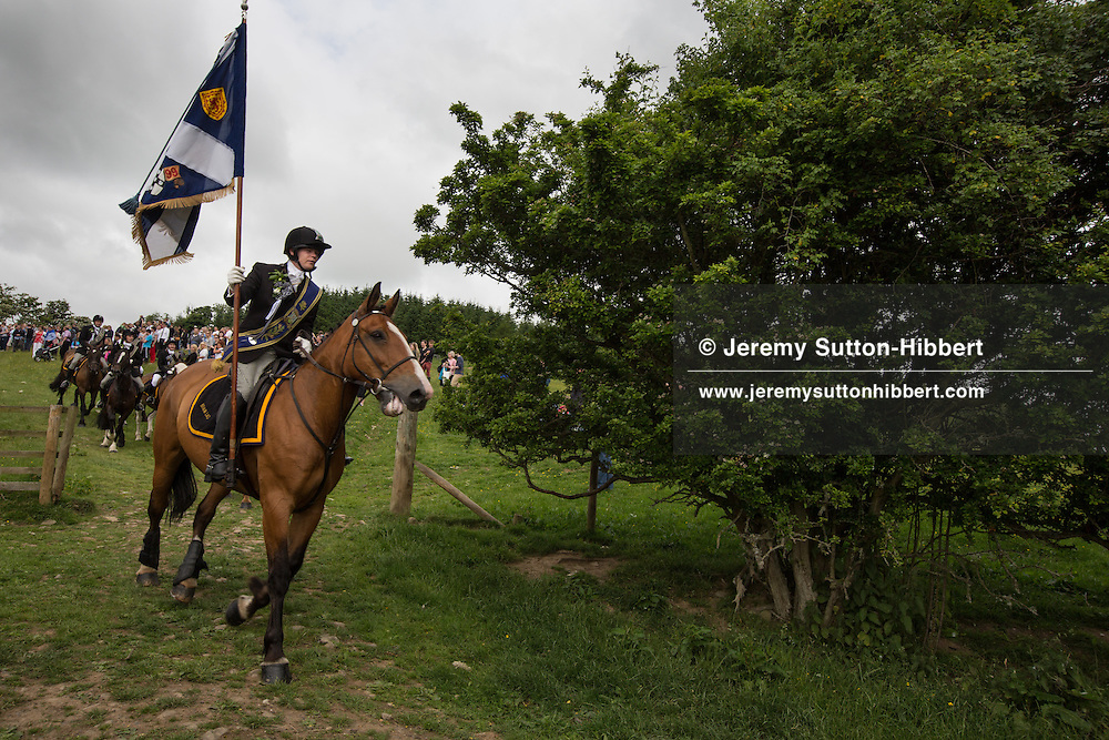 The horsemen gallop over Gala Hill, during the Gala Braw Lads Gathering, with Braw Lad Daniel Whitehead, in Galashiels, Scotland, Saturday 29th June 2013.<br /> N55&deg;36.303'<br /> W2&deg;47.925'