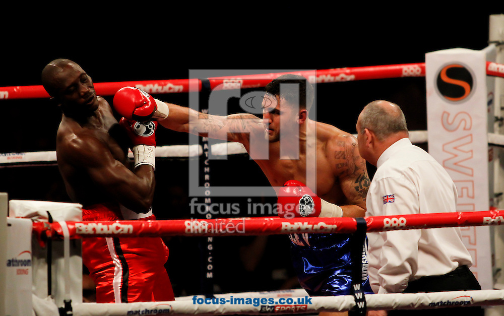 Nathan Cleverly (Blue Shorts) v Sean Corbin (Red Shorts) during their bout for the vacant WBA Inter-Continental cruiserweight title at Motorpoint Arena, Cardiff<br /> Picture by Mike  Griffiths/Focus Images Ltd +44 7766 223933<br /> 17/05/2014