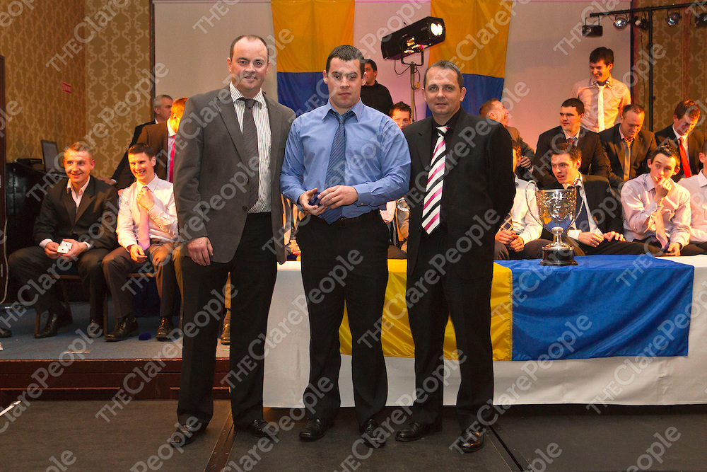 Marty McLoughlin receives his medals from Anthony Daly & Davy Fitzgerald. Photograph by Flann Howard