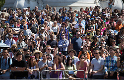 Image ©Licensed to i-Images Picture Agency. 16/07/2014. London, United Kingdom. Bright and hot day with max. temperatures of 27ºC. Dozens of tourists wait in front of Buckingham Palace on a sunny and hot day for the The Queen's guard band to finish their performance. Buckingham Palace. Picture by Daniel Leal-Olivas / i-Images