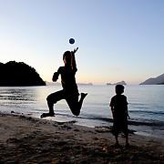 Boys play on a beach near El Nido, Palawan, in the Philippines.