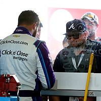Darrell Wallace Jr., driver of the (43) Click n' Close Chevrolet,  is seen signing autographs in the garage area during practice for the 60th Annual NASCAR Daytona 500 auto race at Daytona International Speedway on Friday, February 16, 2018 in Daytona Beach, Florida.  (Alex Menendez via AP)