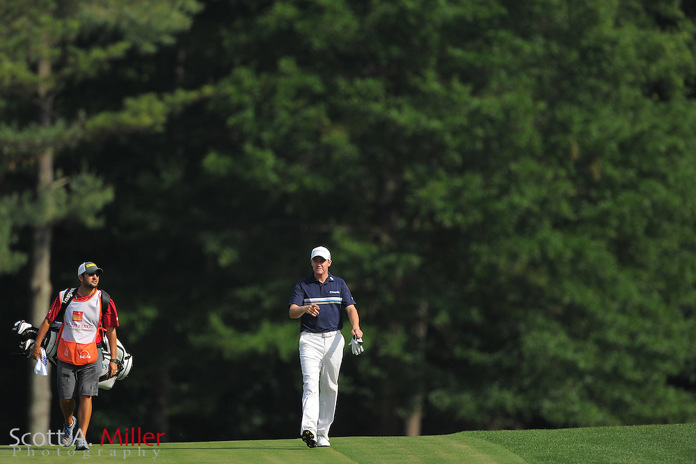 Jimmy Walker and his caddie during the third round of the Wells Fargo Championship at the Quail Hollow Club on May 5, 2012 in Charlotte, N.C. ..©2012 Scott A. Miller.