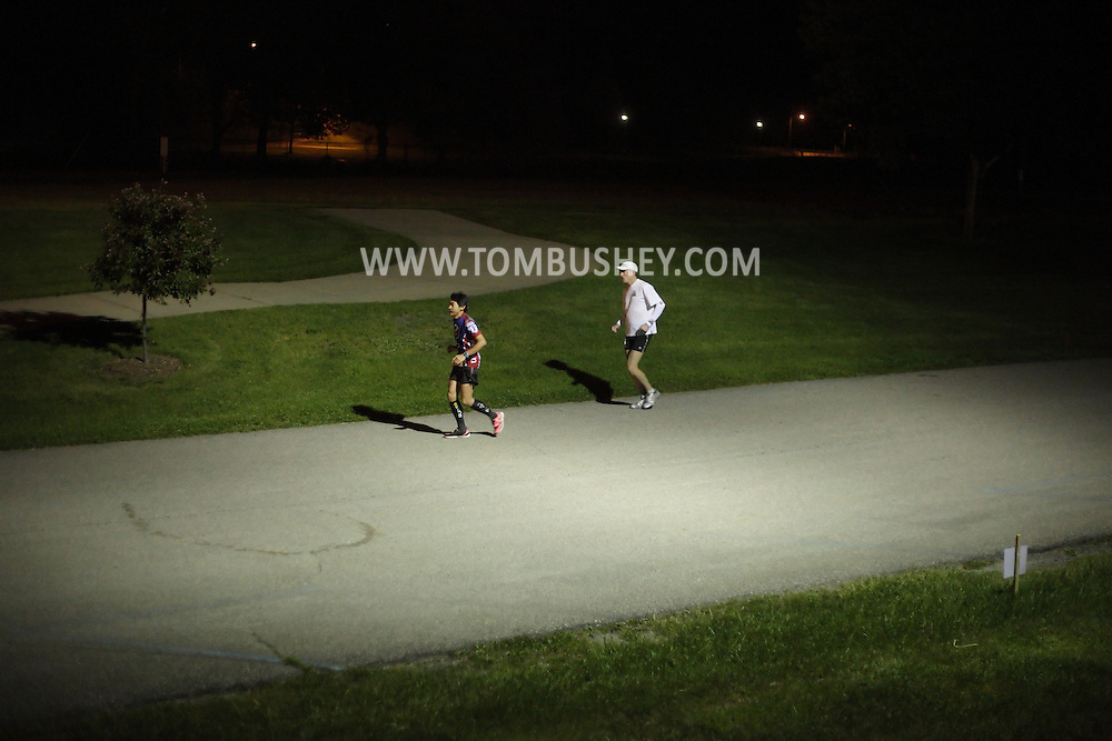Augusta, New Jersey - Tatsunori Suzuki and Scott Brockmeier run at night during the 3 Days at the Fair races at Sussex County Fairgrounds on May 16, 2010. Brockmeier won the men's 48-hour race. Suzuki finished third in the men's 24-hour race.