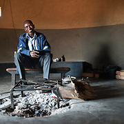 CAPTION: Anisto, a local farmer, in his home. He says he looks forward to the increased variety of crops he'll soon be able to harvest, and that he's delighted that the project is helping this drought-affected area. LOCATION: Nhamo Village, Bikita District, Masvingo Province, Zimbabwe. INDIVIDUAL(S) PHOTOGRAPHED: Anisto Tapera.