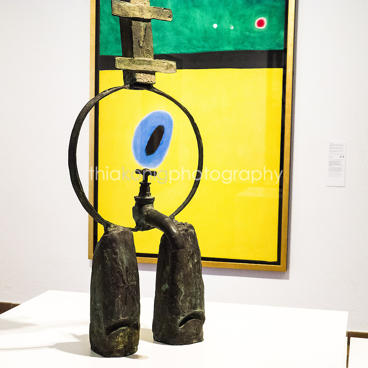 A Miro sculpture is juxtaposed in front of a Miro painting, creating a nod to his artistic style, at the Miro Art Museum in Barcelona, Spain.