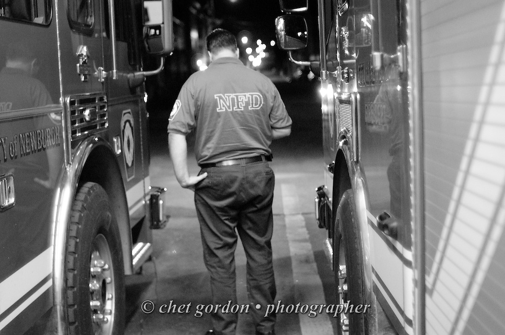 Newburgh firefighter Ed Diller checks his smartphone in the firehouse in Newburgh, NY on Friday night, July 1, 2011. FF Diller is the driver of Ladder Truck #1. The Newburgh Fire Department responds to nearly 3,000 calls a year.  © www.chetgordon.com/blog