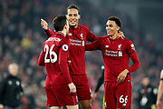 Liverpool defender Andrew Robertson (26), Liverpool defender Virgil van Dijk (4) and Liverpool defender Trent Alexander-Arnold (66) celebrate Liverpool's win 5-0 during the Premier League match between Liverpool and Watford at Anfield, Liverpool, England on 27 February 2019.