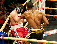 Picture by Alan Stanford/Focus Images Ltd +44 7915 056117<br /> 14/11/2013<br /> Anthony Joshua finishes off  Hrvoje Kisicek  during their heavyweight contest at York Hall, Bethnal Green.