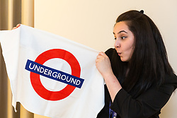 Deputy Hotel Manager Nicky Gashtasbi with a London Underground souvenir tea towel left behind by a guest. London, July 24 2019.