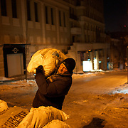 January 24, 2014 - Kiev, Ukraine: A protestor helps to set up a new barricade in one of the main streets that gives access to the makeshift camp in Independence Square, central Kiev. (Paulo Nunes dos Santos)