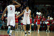 DALLAS, TX - JANUARY 21: Keith Frazier #4 of the SMU Mustangs celebrates after a made three-pointer with teammate Markus Kennedy #5 against the Rutgers Scarlet Knights on January 21, 2014 at Moody Coliseum in Dallas, Texas.  (Photo by Cooper Neill/Getty Images) *** Local Caption *** Keith Frazier; Markus Kennedy