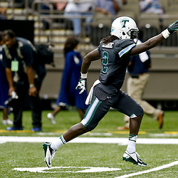 Aug 29, 2013; New Orleans, LA, USA; Tulane Green Wave safety Darion Moore (2) celebrates after a turnover during the second quarter against the Jackson State Tigers at the Mercedes-Benz Superdome. Mandatory Credit: Derick E. Hingle-USA TODAY Sports