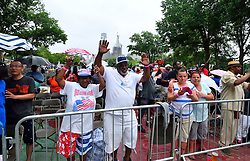 Despite heavy rain thousands attend the July 4th, 2016 Independence Day celebrations on the Benjamin Franklin Parkway, in Center City, Philadelphia, Pennsylvania. The inclined weather shortened the official program.