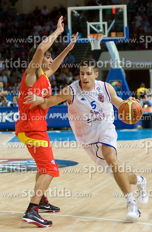 Milenko Tepic of Serbia (R) vs Ricky Rubio of Spain during the basketball match at 1st Round of Eurobasket 2009 in Group C between Spain and Serbia, on September 07, 2009 in Arena Torwar, Warsaw, Poland. (Photo by Vid Ponikvar / Sportida)