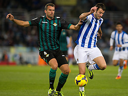 15.12.2013, Anoeta Stadium, San Sebastian, ESP, Primera Division, Real Sociedad vs Real Betis, 16. Runde, im Bild Real Sociedad's Imanol Agirretxe (r) and Betis' Antonio Amaya // Real Sociedad's Imanol Agirretxe (r) and Betis' Antonio Amaya during the Spanish Primera Division 16th round match between Real Sociedad and Real Betis at the Anoeta Stadium in San Sebastian, Spain on 2013/12/15. EXPA Pictures © 2013, PhotoCredit: EXPA/ Alterphotos/ Mikel<br /> <br /> *****ATTENTION - OUT of ESP, SUI*****