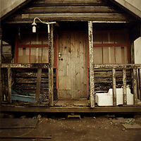 Abandoned fisherman's shed with veranda