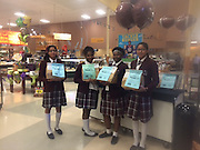 Students from the Young Women's College Preparatory Academy encourage grocery shoppers to contribute to the Souper Bowl of Caring