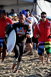 HUNTINGTON BEACH, California/USA (Thursday,Aug 4, 2011) 10-Time ASP World Champion Kelly Slater (Cocoa Beach, FL), 39, runs towards the water to start his heat friday morning at the U.S. Open of Surfing 2011. Photo: Eduardo E. Silva.