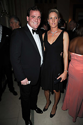 Horse racing figure RICHARD HANNON and his girlfriend JEMIMA ENSOR at the Cartier Racing Awards 2009 held at Claridge's, Brook Street, London on 17th November 2009.