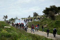March 29, 2019 - Palestinians clash with the Israeli army in the northern West Bank, near the evicted Israeli settlement of Homesh. Palestinians were commemorating the upcoming anniversary of Land Day by planting trees near the settlement when the Israeli army supressed their activities and clashes began. Homesh is an Israeli settlement which was established in 1978 on 173 acres of confiscated land belonging to the nearby Palestinian villages of Burqa, north of Nablus, Silat ad-Dhahr, on the west of Jenin, and Bazaria on the east of Tulkarem. The residents of Homesh were forcefully evicted from their homes and their houses demolished as part of the Israeli disengagement from the Gaza  Strip and from an area in northern Samaria in the West Bank in 2005.The IDF though maintained a requisition order to impede Palestinians from returning to the land for eight years, while the Homesh Yeshiva organization has endeavoured to retain some hold on the area by funding an illegal outpost which has been repeatedly built on the site over the years. The attempt of Palestinians of replanting the area and grazing sheep and goats on the hills around the settlement has usually been met by the violence of settlers and soldiers, thus preventing Palestinians to regain control of their land. The international community considers Israeli settlements in the West Bank illegal under international law (Credit Image: © Mohammed Turabi/IMAGESLIVE via ZUMA Wire)