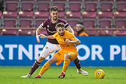 Steven Lawless (#15) of Livingston FC holds off Benjamin Garuccio (#17) of Heart of Midlothian during the 4th round of the William Hill Scottish Cup match between Heart of Midlothian and Livingston at Tynecastle Stadium, Edinburgh, Scotland on 20 January 2019.