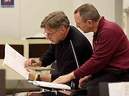 Hank Dahlman (left) and Neal Gittleman compare notes as the women of the Dayton Philharmonic Chorus rehearse for their upcoming performance of Mahler's Third Symphony, Tuesday, January 2, 2007.