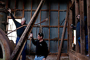 "Chris Carter (center) helps his cousin down after taking photos in a cotton gin that dates back to the 1830s and is rumored to be haunted to follow-up on an investigation. The ""paranormal investigators"" of Twisted Dixie are Grady Carter, Andy Carter, Chris Carter (all related), and Chris Phillips, seen in Antreville, South Carolina November 4, 2011."