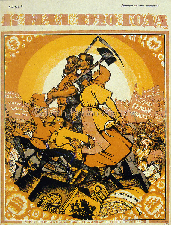 May Day 1920. On the ruins of capitalism the fraternity of peasants and workers marches against the peoples of the world. Artist, Nicolas Kotcherguine.  Soviet Social Realism.