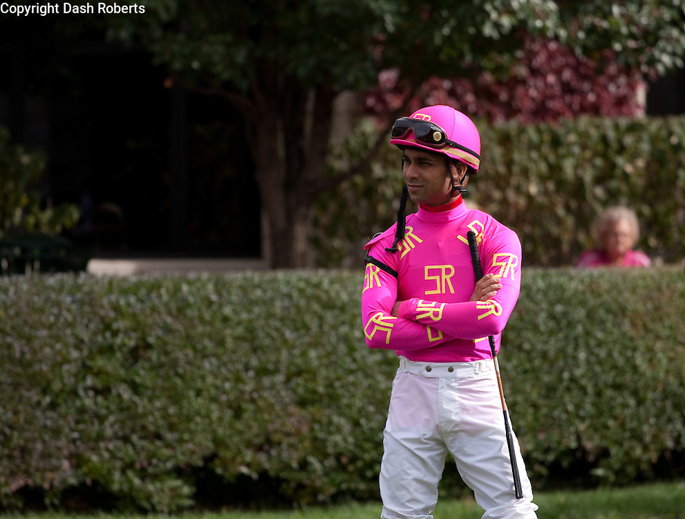 Jockey Shaun Bridgmohan awaits his mount in the paddock at Keeneland during the 2009 Fall Meet.