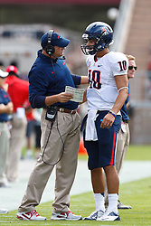 PALO ALTO, CA - OCTOBER 06: Head coach Rich Rodriguez of the Arizona Wildcats talks to quarterback Matt Scott #10 on the sidelines against the Stanford Cardinal during the second quarter at Stanford Stadium on October 6, 2012 in Palo Alto, California. The Stanford Cardinal defeated the Arizona Wildcats 54-48 in overtime. (Photo by Jason O. Watson/Getty Images) *** Local Caption *** Rich Rodriguez; Matt Scott