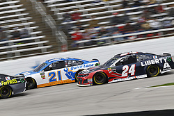 April 8, 2018 - Ft. Worth, Texas, United States of America - April 08, 2018 - Ft. Worth, Texas, USA: Paul Menard (21) and William Byron (24) battle for position during the O'Reilly Auto Parts 500 at Texas Motor Speedway in Ft. Worth, Texas. (Credit Image: © Chris Owens Asp Inc/ASP via ZUMA Wire)